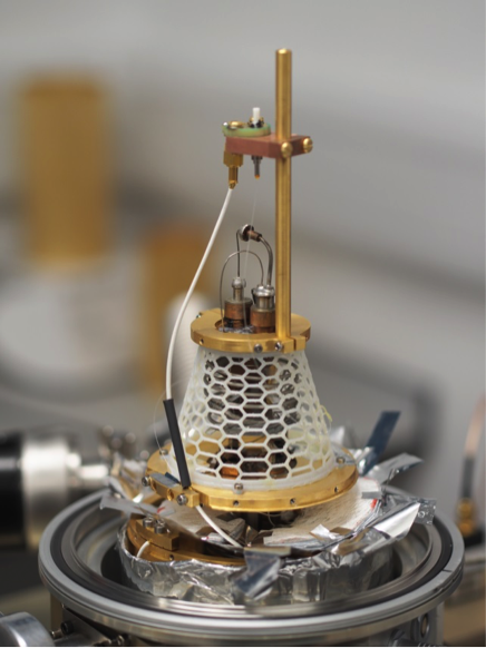 A superconducting single-photon detector mounted in the miniaturized cooler